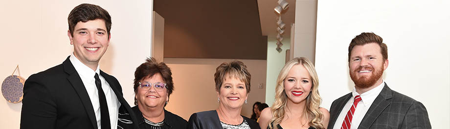 Debbie Gann, centered WSU Board of Trustees award honoree with her family at the WSU Foundation's Fairmount Society event