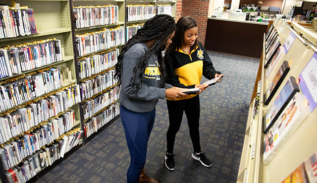 Wichita State students looking for books in the Ablah Library