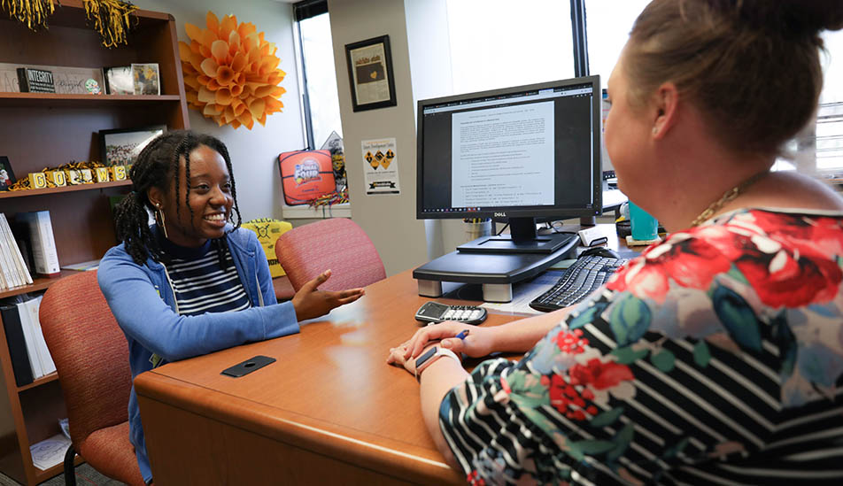 Wichita State student visits with her advisor in Fairmount College of Liberal Arts and Sciences