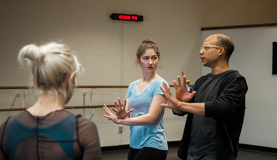 Wichita State student learning dance from New York City guest lecturer
