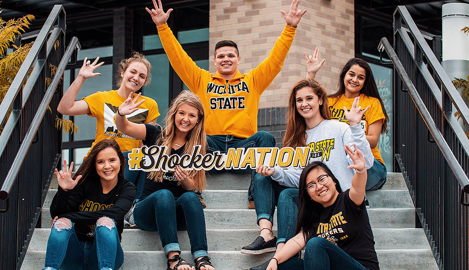 Wichita State students pose for a photo on campus