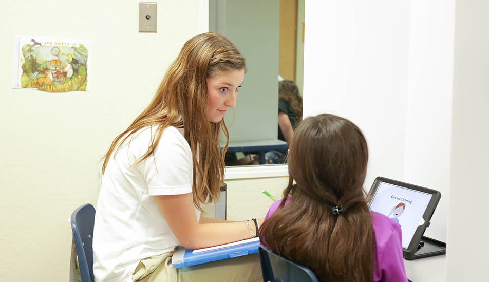 Wichita State University student practicing applied learning experiences in Speech Language Pathology program