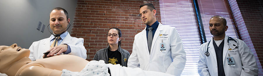 Wichita State health professions students practice what they've learned in the classroom