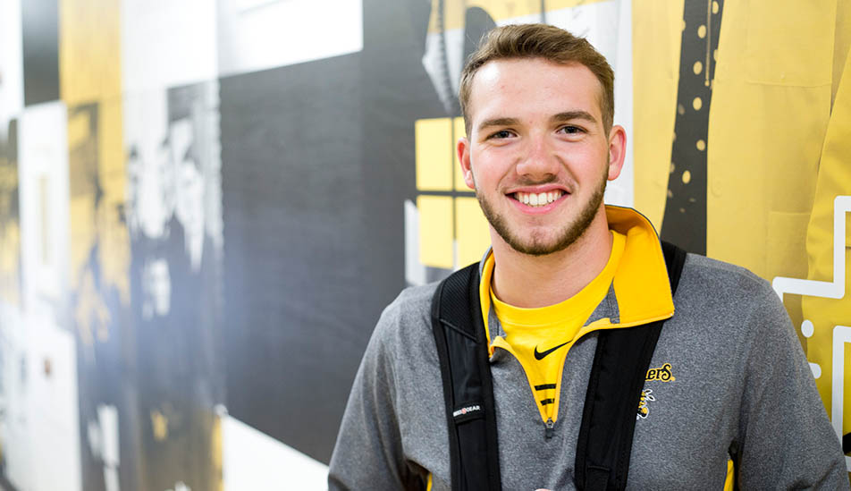 Wichtita State Student Austin Nordyke majoriting in Engineering Technology is inside the Rhatigan Student center