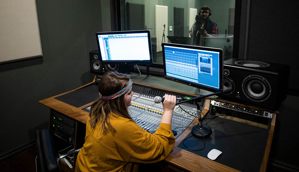 Wichita State Audio Production student recording a student at Shocker Studios