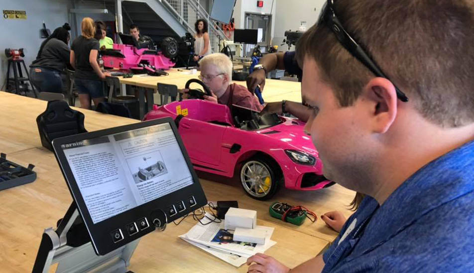 Wichita State College of Engineering students adpat cars for special needs kids in the Go Baby Go applied learning program