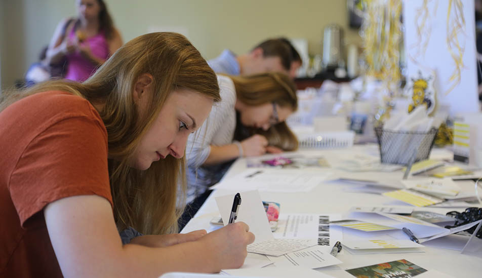 Wichita State students write thank you cards to show appreciation to their donors