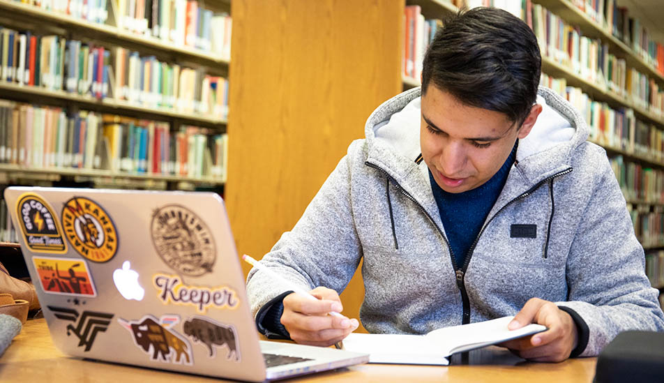 Wichita State student studying in the Ablah Library