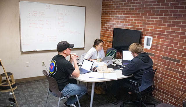 Wichita State students study together in one of the study group rooms in the Ablah Library