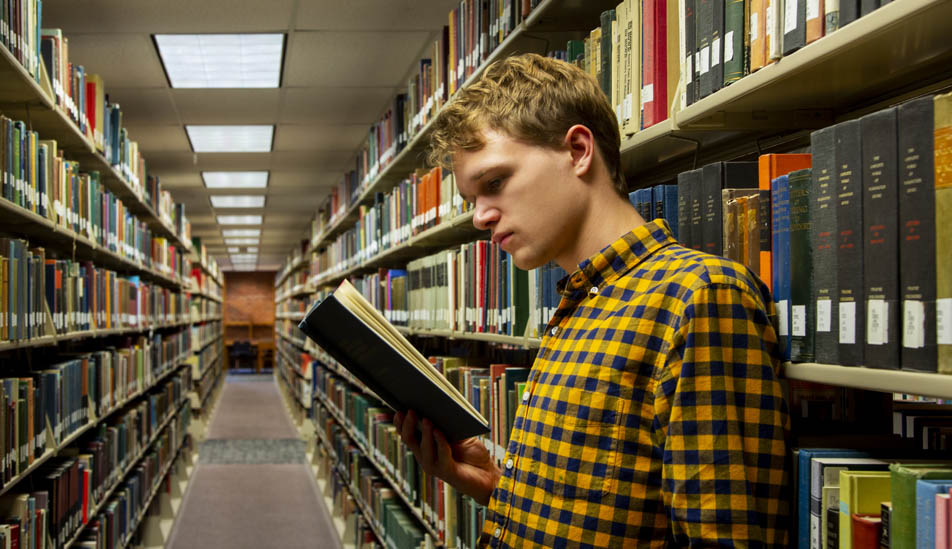 Daniel Saunders studying in the Ablah Library at Wichita State University