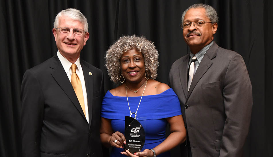 Junetta and Victor Everett receive a Lifetime Achievement award from Interim President Andy Tompkins at the President's Club at Wichita State University