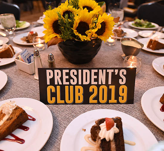 Table decor and dessert at Wichita State University's President Club member celebration