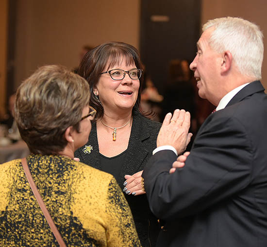 Chad and Deb Clark visit with Alisa Unruh at Wichita State University President's Club member celebration held annually