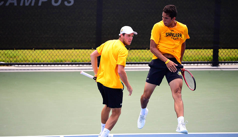 Wichita State Men's tennis double partners at a critical point in a match