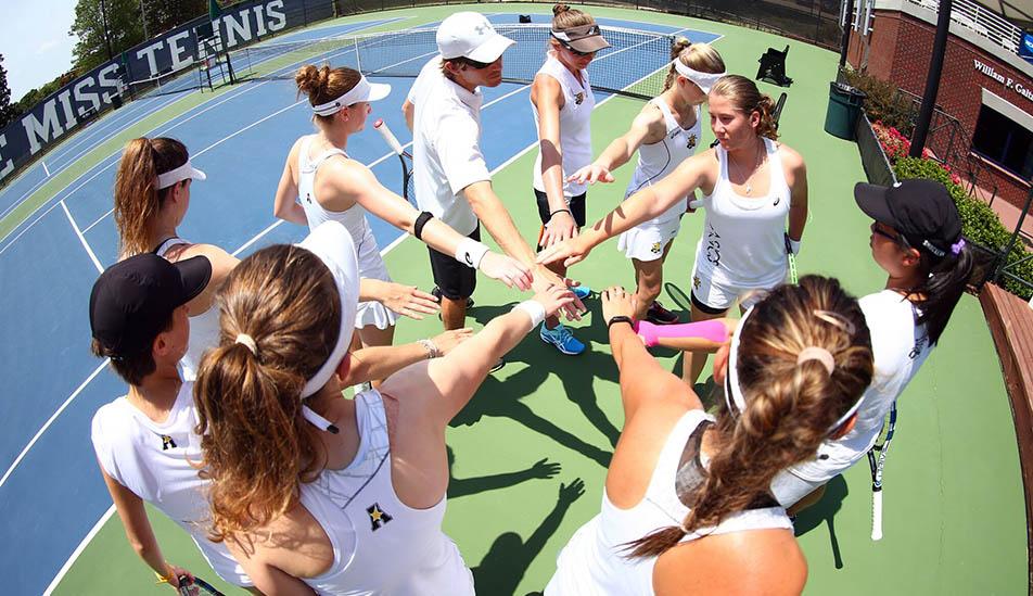 Wichita State Women's Tennis team at the start of a tennis tournament